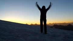 Winning  silhouette woman  with his arms raised above his head in celebration Stock Footage