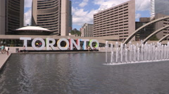 Huge 3D Toronto sign in front of city hall downtown Stock Footage