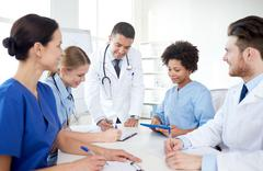group of happy doctors meeting at hospital office - stock photo