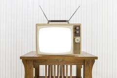 Old Television with Antenna on Wood Table with Cut Out Screen Stock Photos