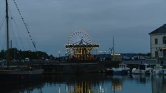 France - Timelapse of Ferris Wheel and Carousel in Honfleur Stock Footage