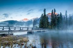 Canadian Landscape: Misty Sunrise at Pyramid Lake in Jasper, Alberta Stock Photos