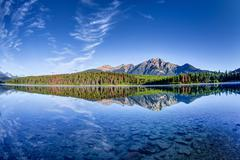 Colorful trees lined the shores of Patricia Lake at Jasper National Park with - stock photo