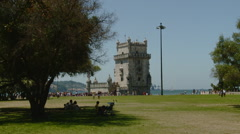 Portugal - Family Picnic under Tree at the Fortress Torre de Belem in Lisbon Stock Footage