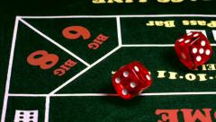 Red Casino Dice Land on Seven Slow Motion Stock Footage