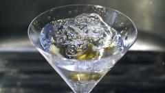 Martini Glass Shakes after Olive Splash Super Slow Motion - stock footage