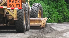 ROAD GRADER, pan right - stock footage