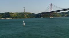 Portugal - Sailboat Passing under 25th of April Bridge Stock Footage