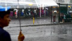 People wade through a water logged street after heavy downpour in Istanbul Stock Footage