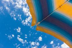 Beach umbrella a on sunny summer day Stock Photos