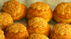 Hot and gliden choux buns from oven - rotating close up shot 1 - stock footage
