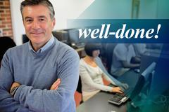 Well-done! against teacher smiling at top of computer class - stock photo