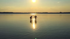 SLOW MOTION: Two men running along the water - stock footage