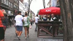 Unidentified tourists and locals in the area of cafe and  restaurants Stock Footage