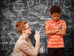 Stock Photo of Composite image of teacher begging boy