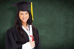 Stock Photo of Composite image of a woman standing to the side slightly with her degree and