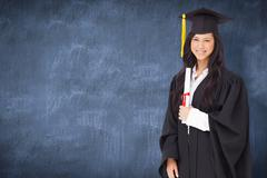 Composite image of a smiling woman holding her degree as she has graduated from - stock photo