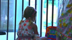 Stock Video Footage of Adorable blonde toddler girl playing in the home with children's educational com