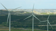 Stock Video Footage of Alternative energy generation, nature conservation. Wind turbines, green hills
