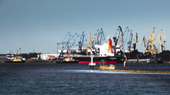 Two tugboats from the port pulls a large ship Stock Footage