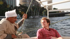 Two Men Sailing down the Nile River in downtown Cairo, EGYPY Stock Footage
