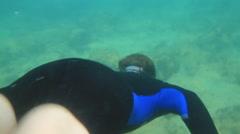 Man Free Diving Mediterranean Sea Ruins near Caesarea Stock Footage