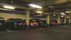 Passenger car with German number plates leaves the underground parking - stock footage