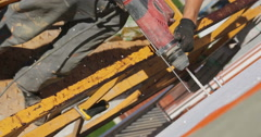 Construction. Man drills wall with perforator. - stock footage