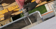 Construction. Man drills wall with perforator. Stock Footage