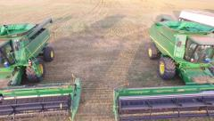 John Deere Combines Lined Up - Fly Over Stock Footage