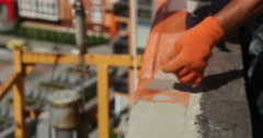 Construction. Man strengthen construction netting.. - stock footage