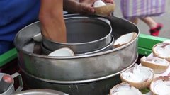 Coconut Ice cream at street food in Thailand, Bangkok Stock Footage