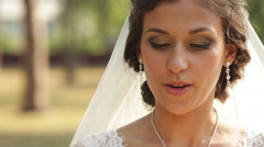 happy bride walking in a park - stock footage