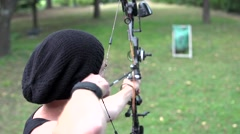 Archer dressed in black shooting on sight disc, close. Stock Footage