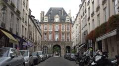 Road entrance leading to  Place des Vosges, Paris, France. Stock Footage
