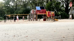 Unidentified children and parents in the children's playground Stock Footage