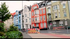 Brightly painted buildings in Oberkassel, the old district  of  Dusseldorf Stock Footage