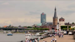 Waterfront of the river Rhine in Dusseldorf in summer cloudy and overcast day Stock Footage