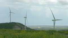 Alternative power sources, green energy generation, wind farm in stormy field Stock Footage