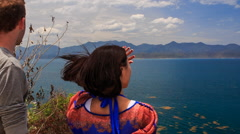 Guy girl admire scenery of seascape watch sea and island Stock Footage