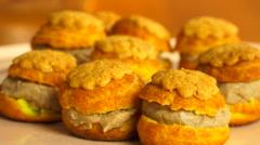 Choux buns with praline custard - rotating close up shot Stock Footage