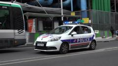 A French Police car with flashing lights in Paris, France. - stock footage