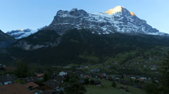 Switzerland Grindelwald Eiger, mountain town Alps sunrise time lapse - stock footage