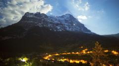Eiger Switzerland town night cloudscape outdoor travel landmark time lapse Stock Footage