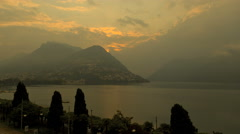 Lake Lugano sunset cloudscape water valley travel tourism scenic time lapse Stock Footage