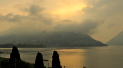 Italy tourist valley dusk Lake Lugano water sport travel tourism time lapse - stock footage