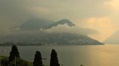 Sunset cloudscape Lake Lugano Italy tourism travel water sport time lapse Stock Footage