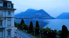 Lake Lugano dusk lights travel tourism vacation sport destination time lapse - stock footage