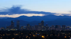 Illuminated skyline Denver USA downtown city building Rockies mountain travel Stock Footage