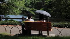 Young couple sits on bench. Stock Footage